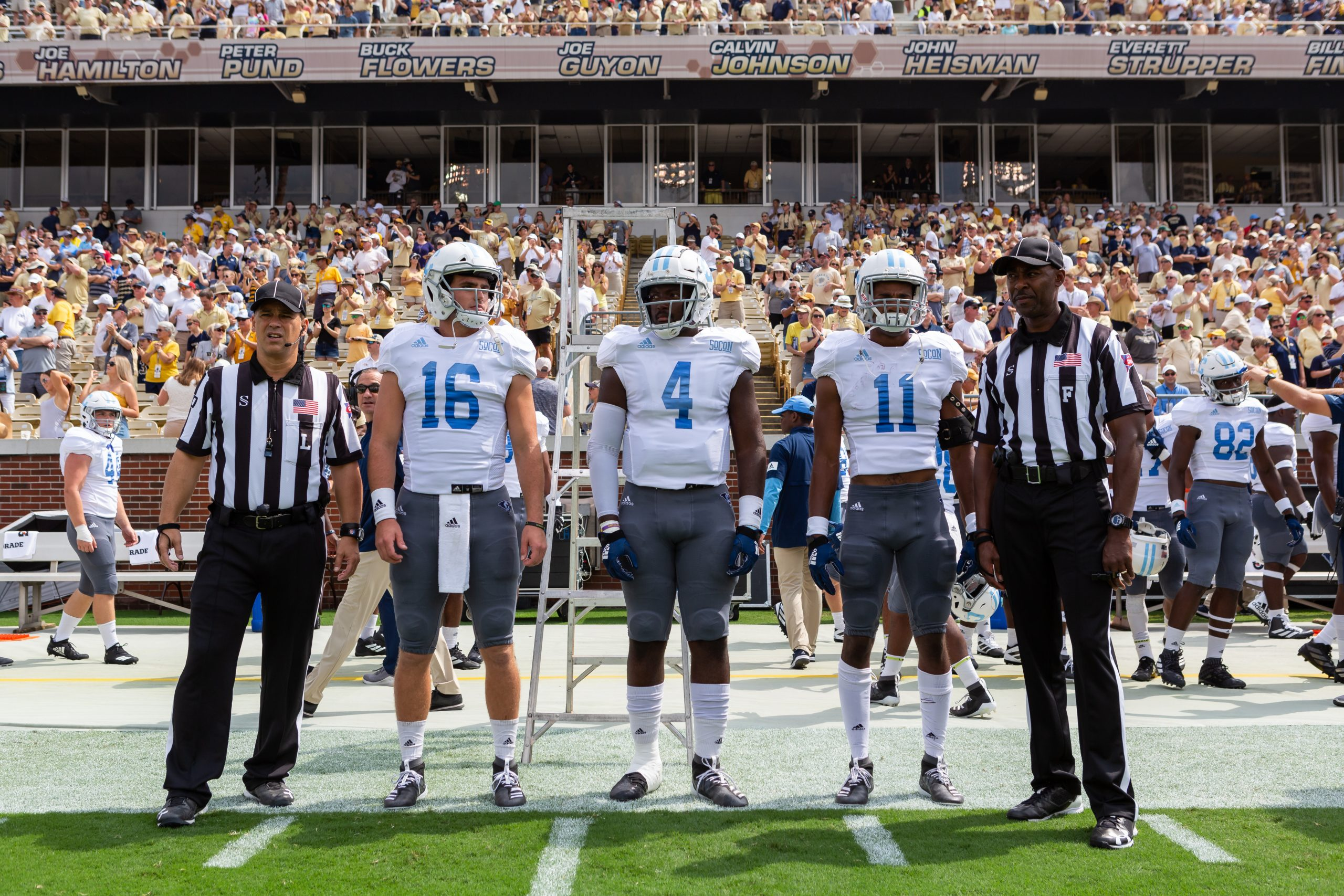 Citadel Brigadiers Foundation football players on sidelines with referees