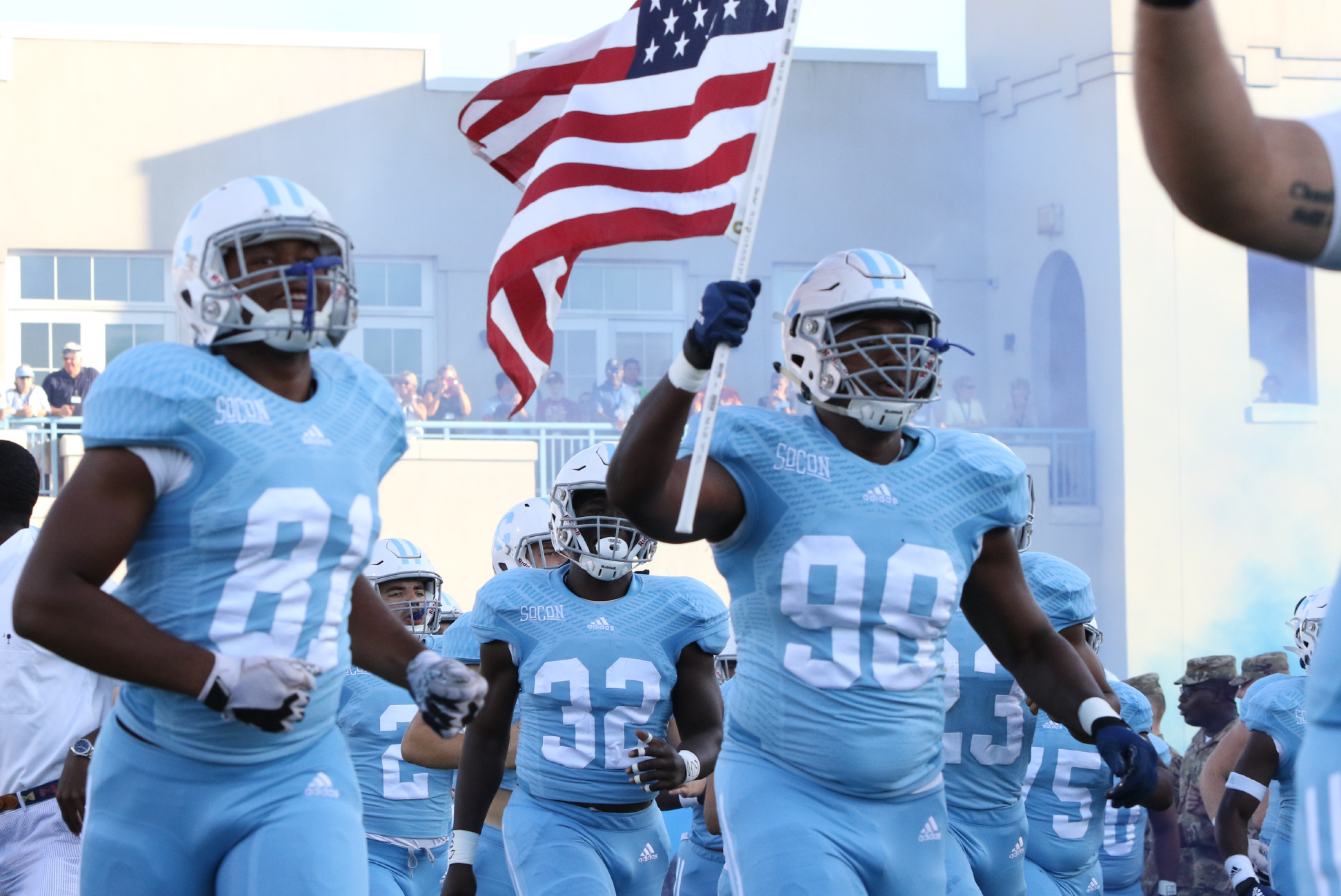 Citadel Brigadiers Foundation football team carrying american flag